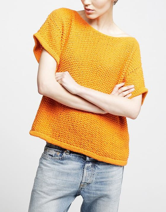 Orange knitted Julio T-shirt from Wool and the Gang worn with faded denim jeans