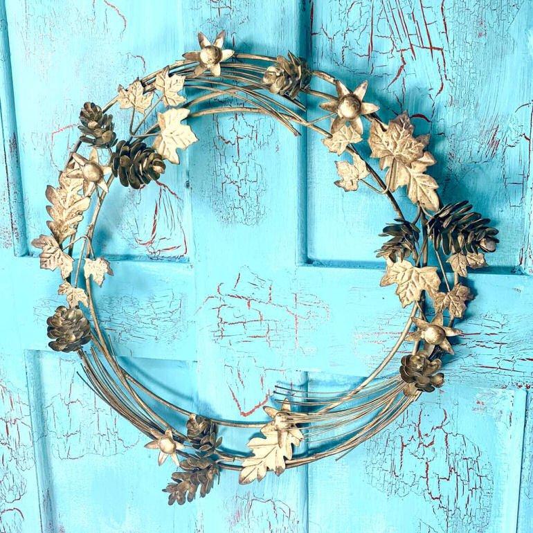 Contemporary brass door wreath