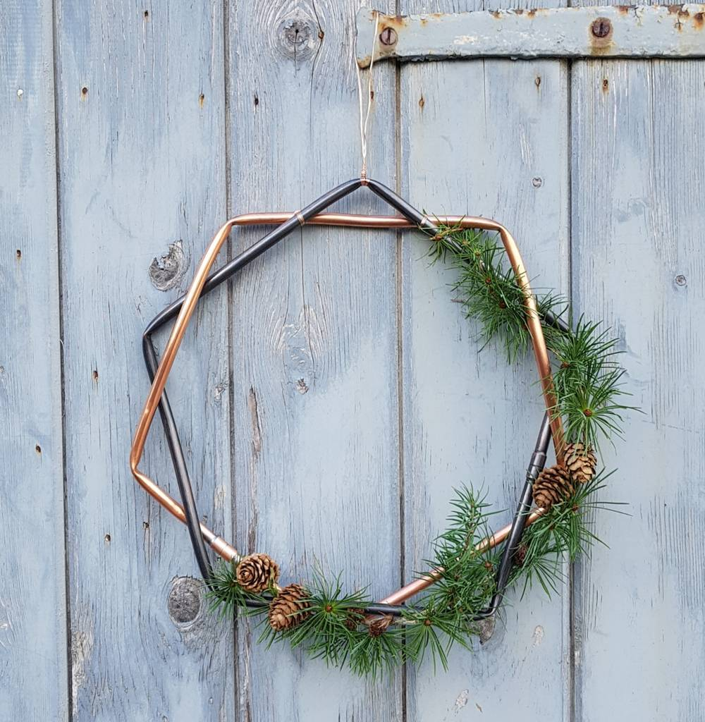 Alternative Christmas Wreath made of copper tybe and pine cones and greenery