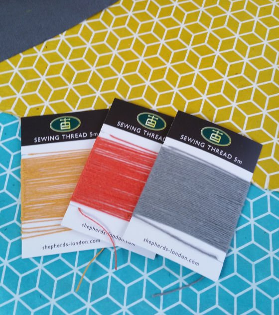 Bookbinding supplies: colourful lokta papers and linen threads
