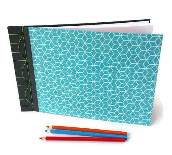 Grey bookcloth and turquoise lokta paper stab bound handmade journal with coloured pencils