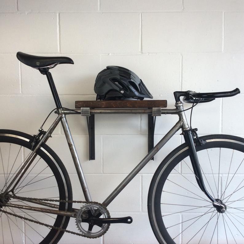 Bike wall hanger in reclaimed timber