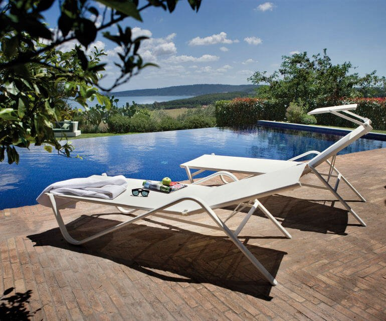 Emu Holly stackable contemporary sun loungers in cream by infinity pool