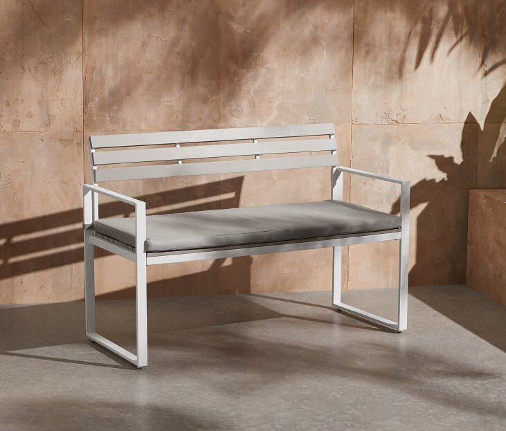 Small garden bench in white with padded cushion
