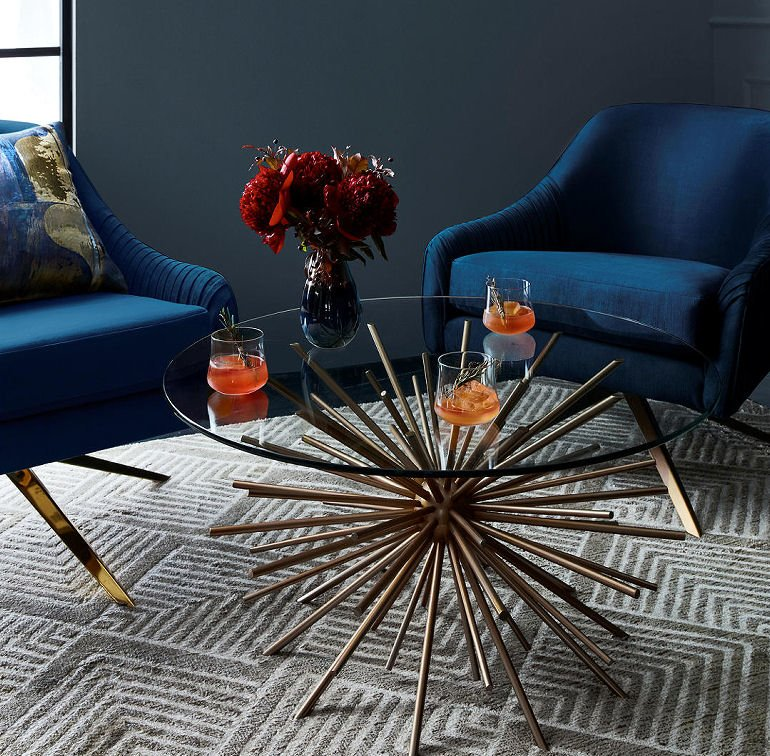 West Elm Sputnik glass coffee table with blue velvet chairs