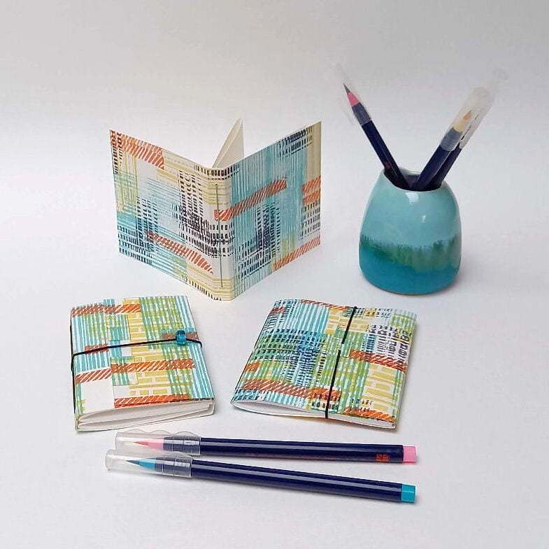 Hnad-stamped mini sketchbooks - perfect stocking filler gifts by Aqua Handmade Books