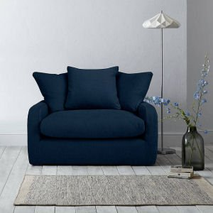 Dark blue snuggler armchair at John Lewis & Partners