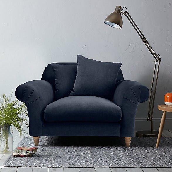 Blue velvet snuggler armchair by Loaf