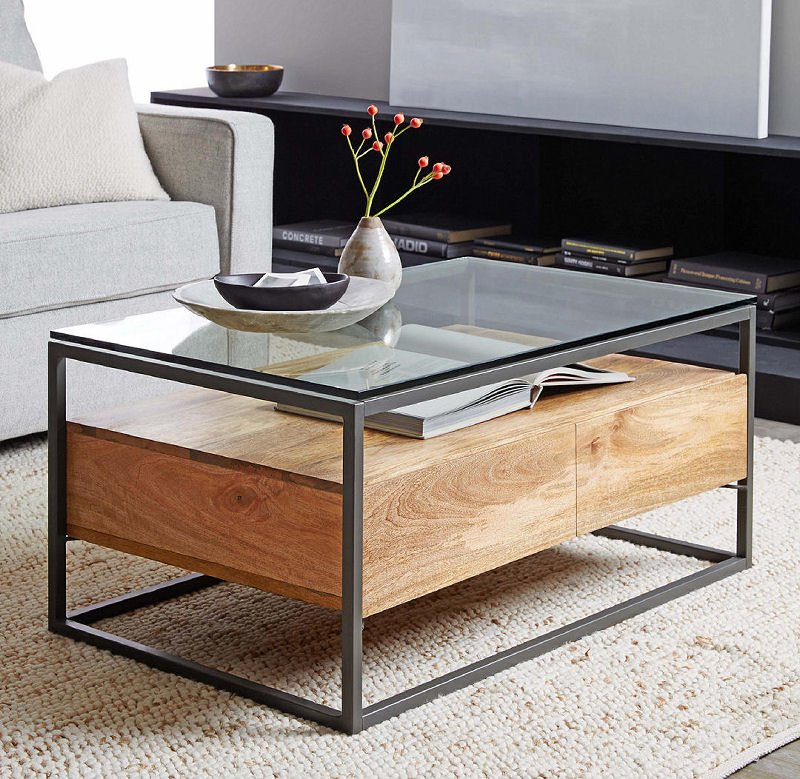 West Elm Industrial Storage Coffee Table in mago wood with glass top and blackened steel frame