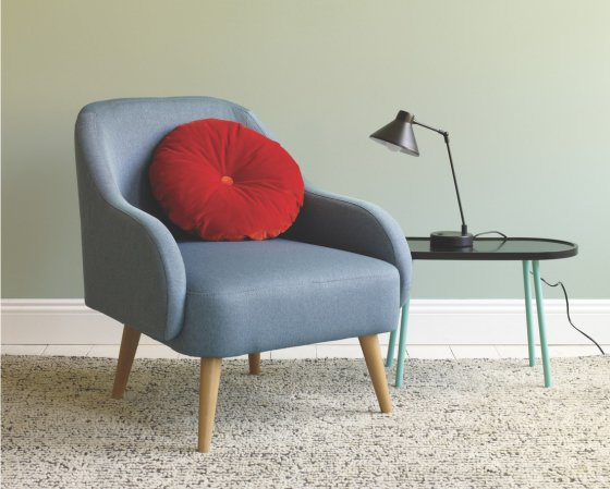 Habitat Momo armchair for small spaces with red cushion next to side table with lamp