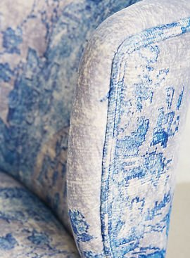 close up of blue and white Moresque accent chair by Anthropologie
