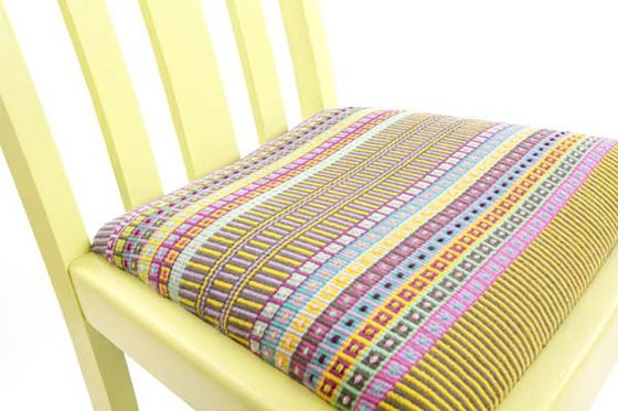 Upcycled yellow chair with brightly coloured handwoven textile seat