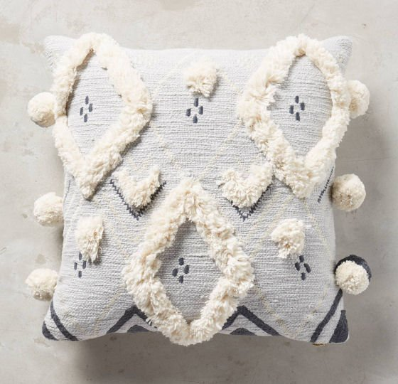 Light grey Anthropologie cotton cushion with white tufted diamonds and pompoms