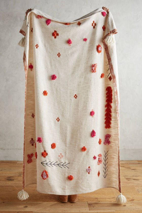 White Anthropologie cotton throw with pink & orange tufting and geometric embroidery