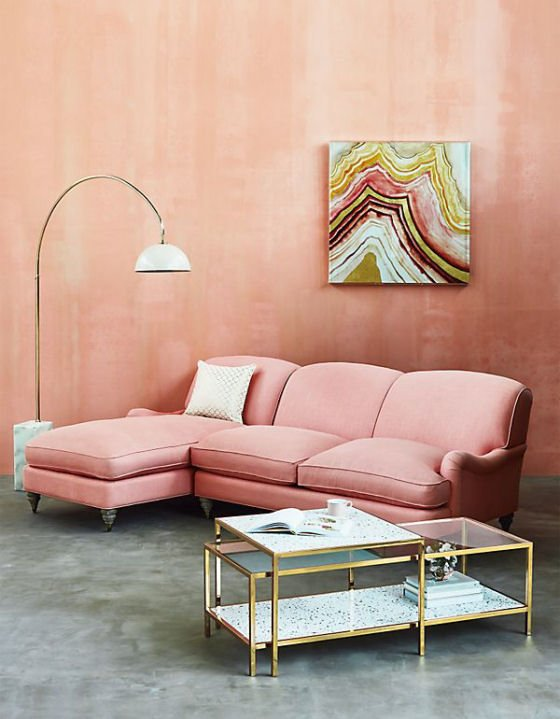 Anthropologie Framed Terrazzo Coffee Tables with pink sofa and grey concrete floor