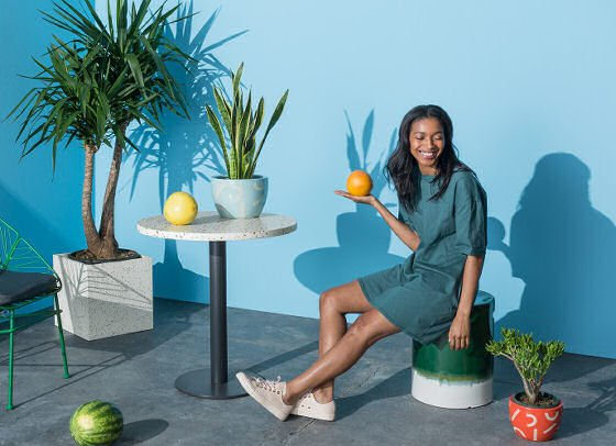 Contemporary, colourful outdoor stool and garden furniture with plants in outdoor room