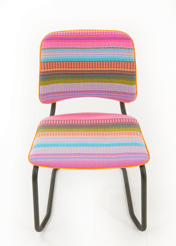 Handwoven textile by Angie Parker in fuschia pink, turquoise, green and orange as chair upholstery