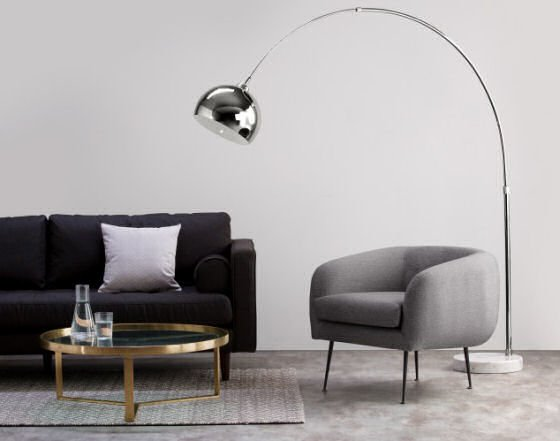 The Bow Chrome Floor Lamp, part of the stunning contemporary lighting collection by MADE.COM