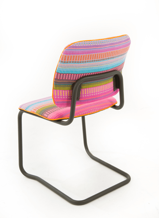 Back view of upcycled chair with steel frame and brightly coloured woven fabric seat and back