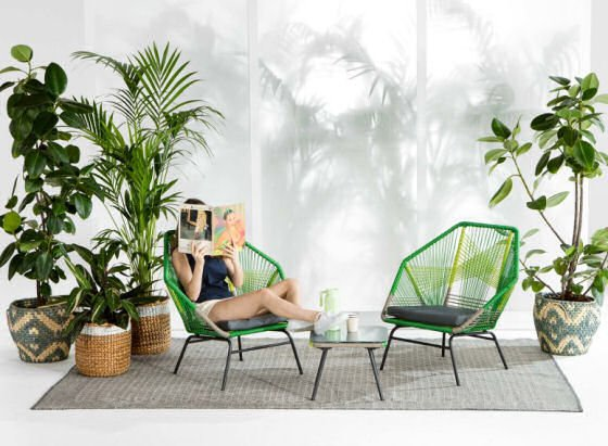 how to create an outdoor room with plants in baskets and colourful garden furniture