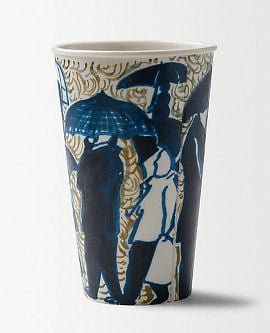 Latte cup with blue figures and umbrellas from Anthropologie