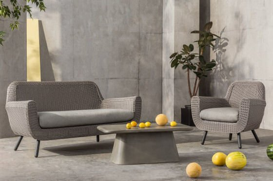 Jonah outdoor sofa and armchair with Kalaw outdoor concrete table in outdoor room