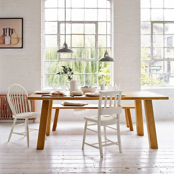 John lewis Glendale oak dining table and bench with white chairs in light-filled contemporary space