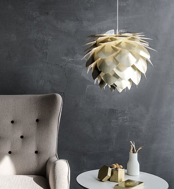 Vita Silvia lampshade in brushed brass against grey polished plaster walls