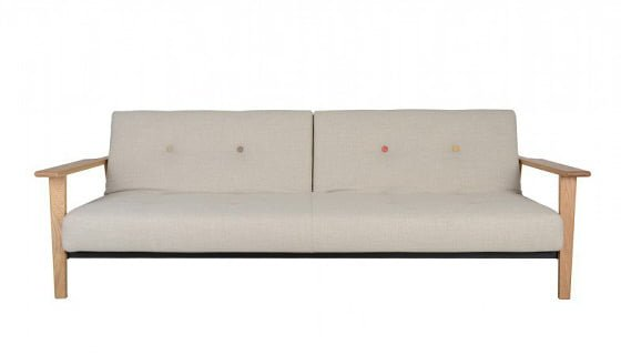 Mid-century style Heal's Knap Sofa Bed with wooden arms in cream with coloured buttons