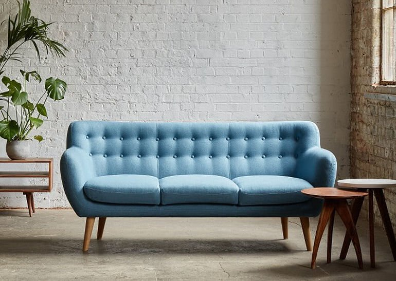 Compact, stylish Mimi sofa for small living spaces in blue with mid-century style features
