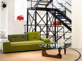 Aram store interior with green sofa