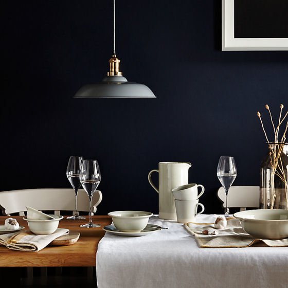 John Lewis Croft Collection tableware and glasses on wooden table against a dark blue wall