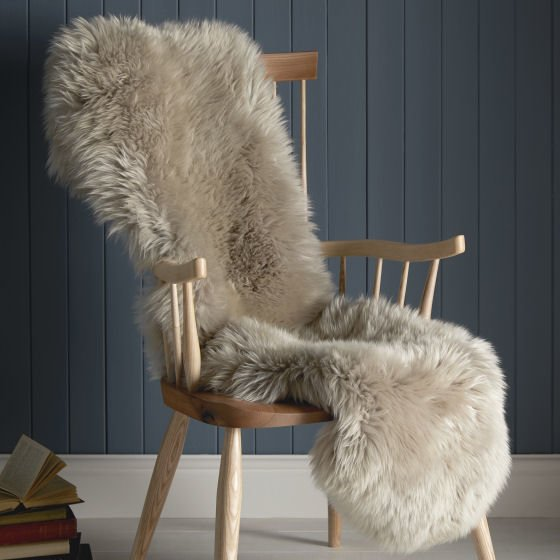 Melbury Armchair with sheepskin rug from John Lewis