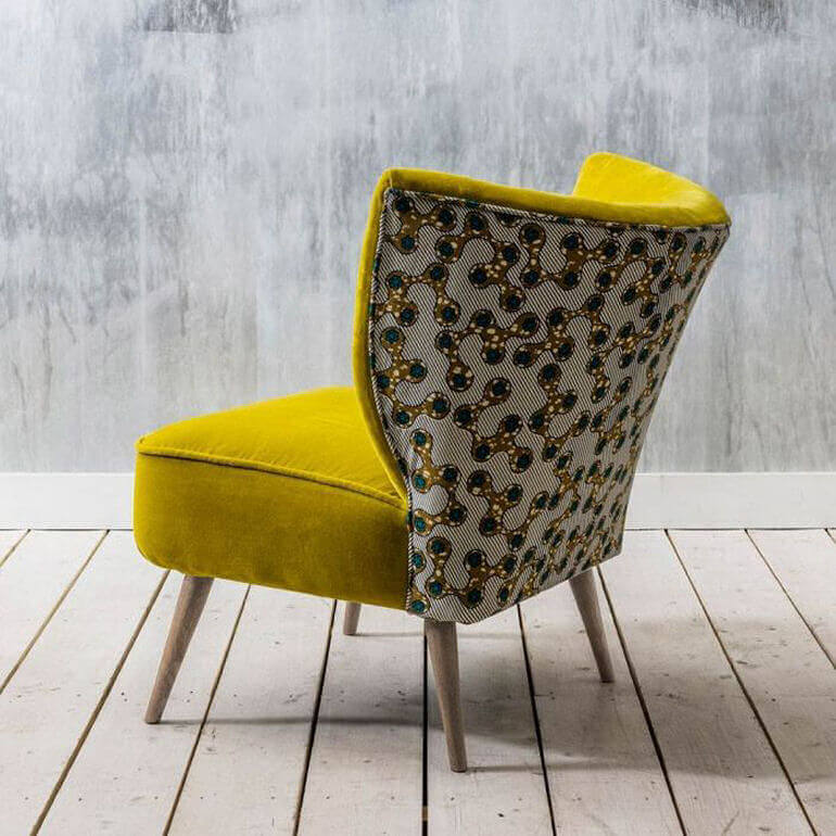 Alpana yellow velvet cocktail chair with printed cotton back