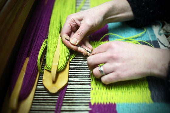 Angie Parker, weaving at her loom