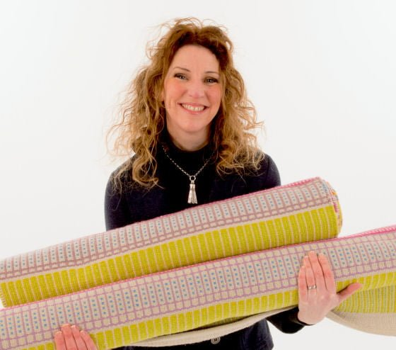 Angie Parker with her colourful Bodacious Handwoven Eco Rugs