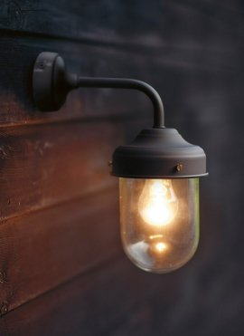 Garden Trading Barn Outdoor Light in Coffee Bean on brown wooden wall