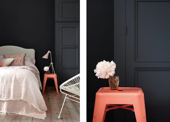 dark blue bedroom wall in Basalt by Little Greene with coral stool