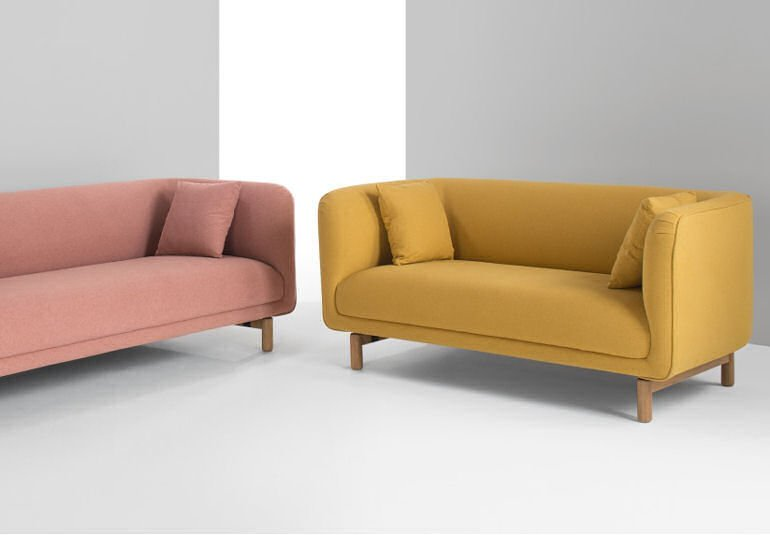 MADE plump and comfortable Becca sofas for small spaces in blush pink and yolk yellow