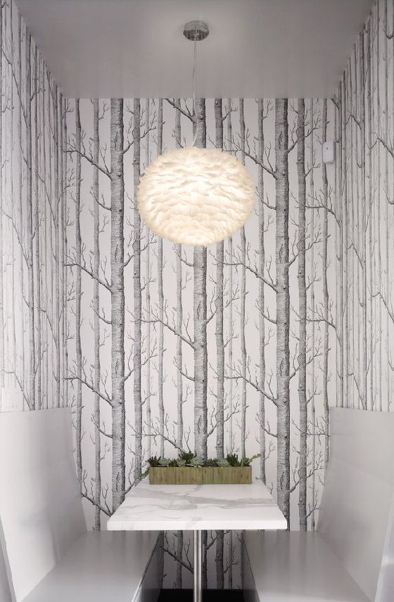 Eos feather pendant light hung in dining alcove with tree wallpaper