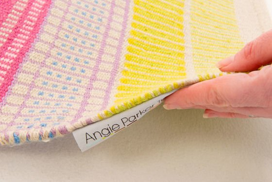 Detail of handwoven colourful Eco-Rug made from PET yarn from recycled plastic bottles