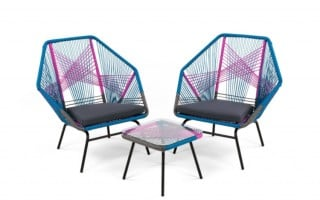 Colourful garden chairs and table in pink and blue