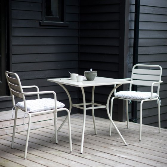 Dean Street Contemporary Bistro Set in light grey on deck against dark grey lapboard walls