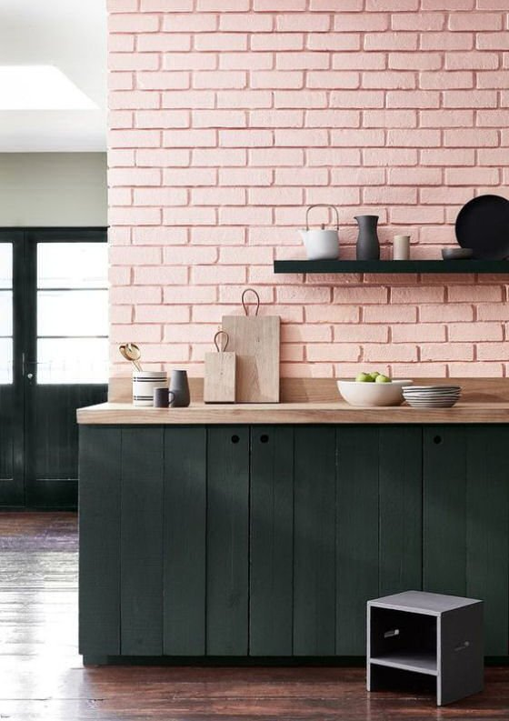 contemporary pink brick kitchen wall with dark stained wood units
