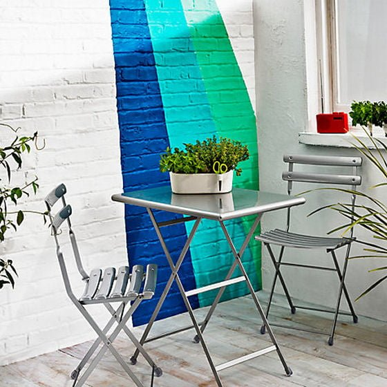 Silver grey metallic bistro set from John Lewis on colourful terrace