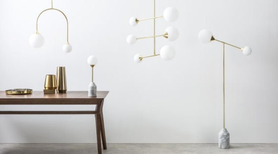 The Faye Contemporary Lighting Collection teams marble and brass with clean, graphic shapes. Get the 'modern luxe' look without breaking the bank #marble #brasslights #brass