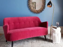 Pink sofa by Graham & Green against blue wall