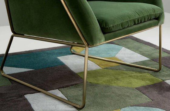 Grass green velvet armchair detail of brass legs