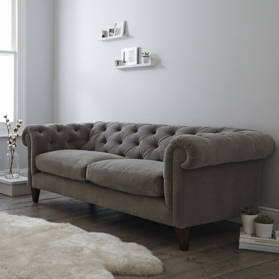 Contemporary grey velvet Chesterfield sofa in room setting