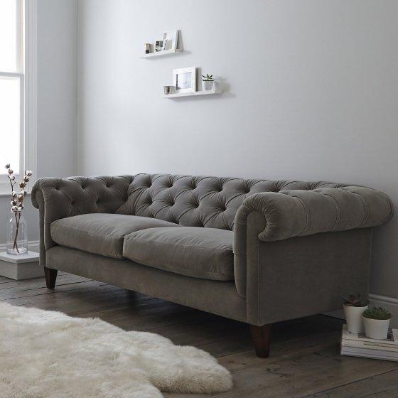 Contemporary grey velvet Chesterfield sofa in room setting